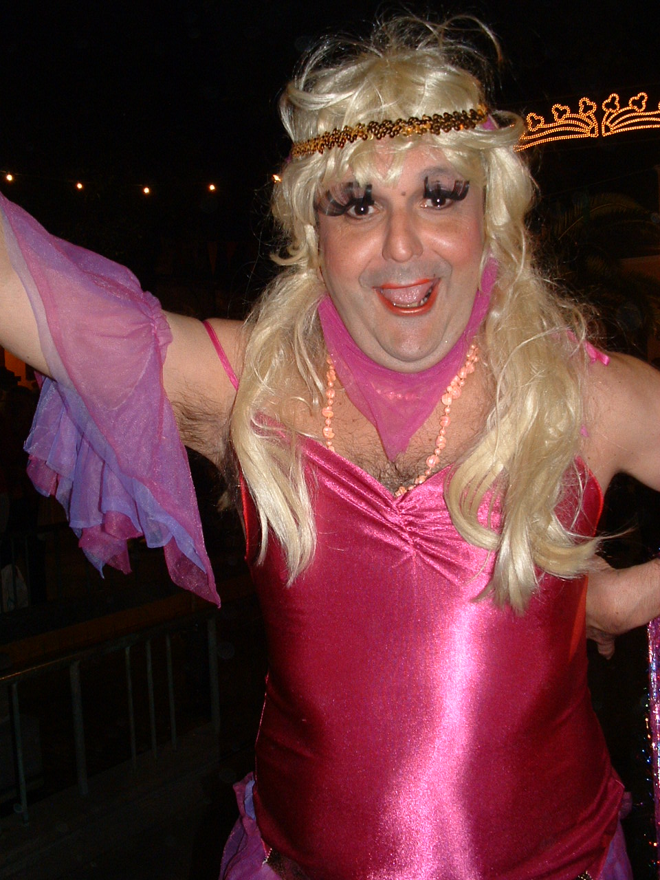Man dress in pink flapper costume, and blonde wig, Ambassador's Parade, Santa Cruz de La Palma, 2006