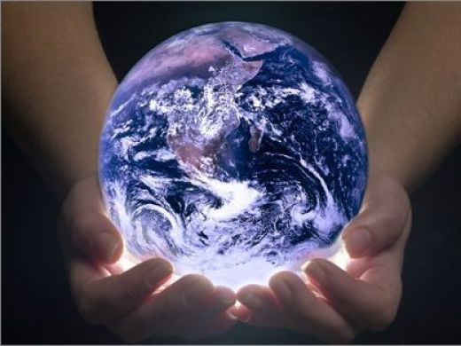 HAnds holding a glowing Earth