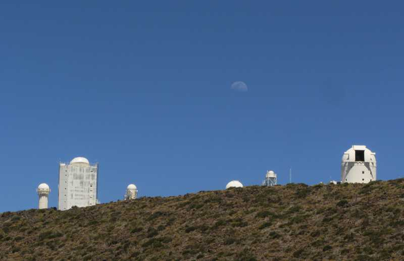 The Teide Observatory with the moon rising.