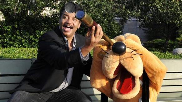 Neil deGrasse Tyson, head of the Hayden Planetarium in New York City, celebrating with Pluto