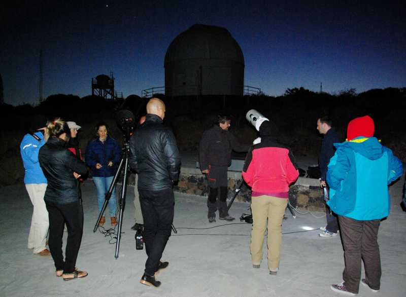 Two telescopes plus people enjoying them