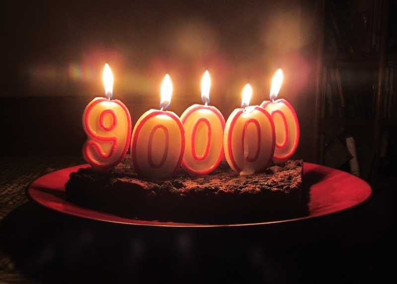 Brownies with number candles spelling out 90,000