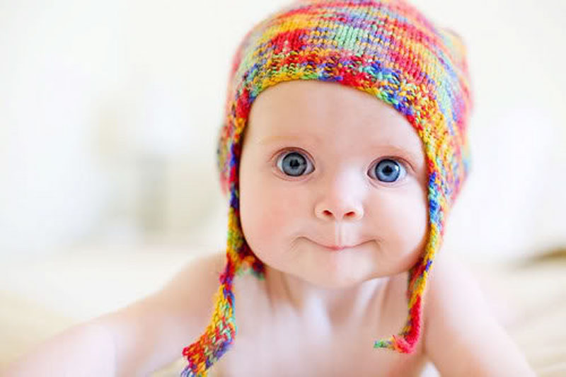 Baby in a bright hat